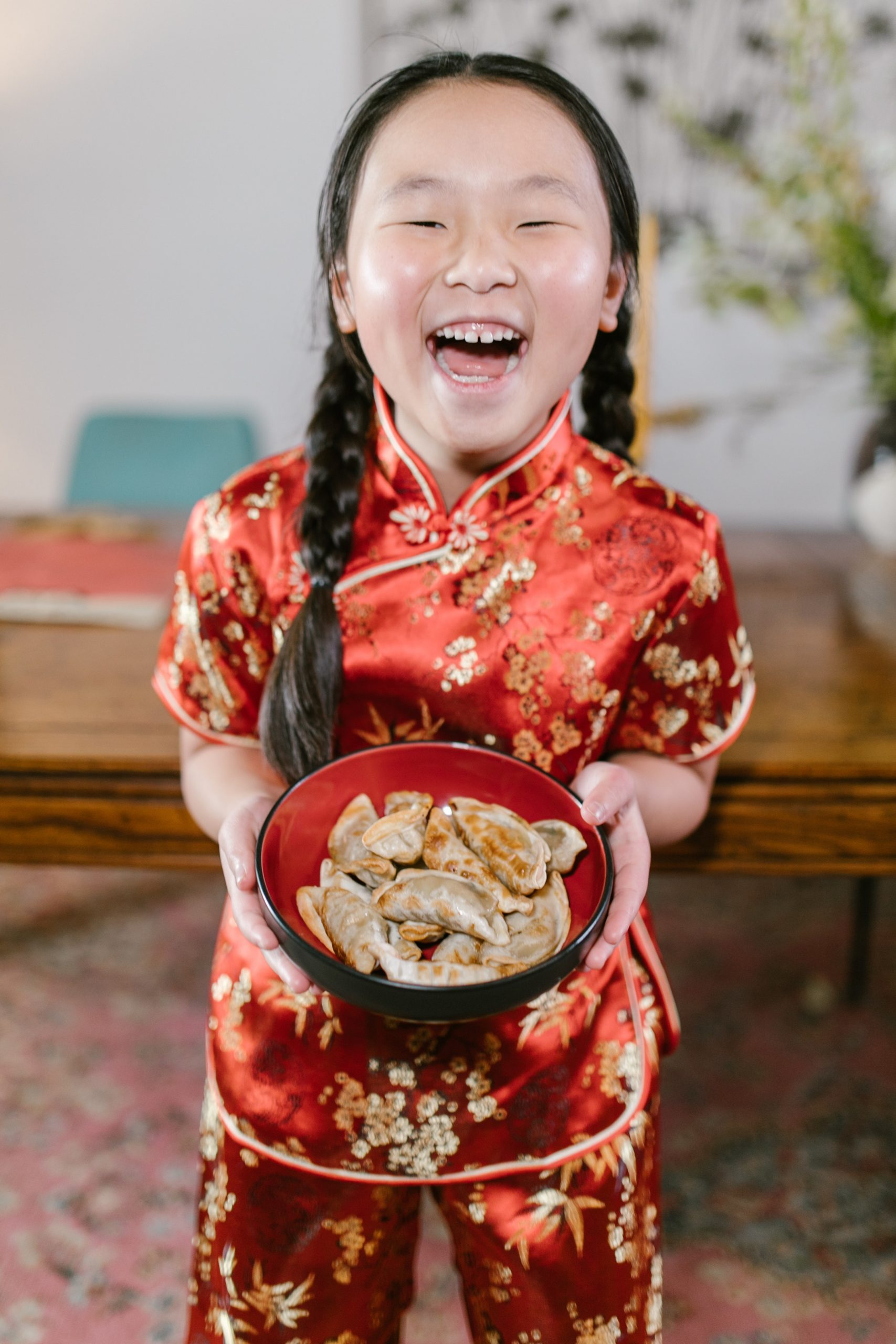 Chinese girl holding traditionally made dumplings